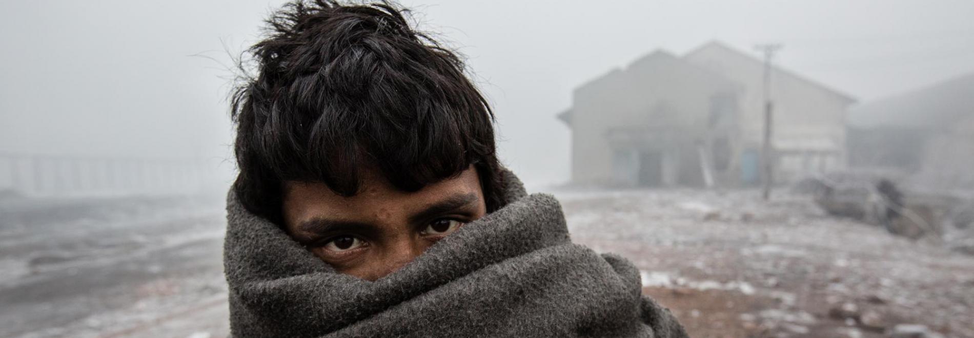 Ein Flüchtling auf dem Balkan. Foto: Kristof Vadino