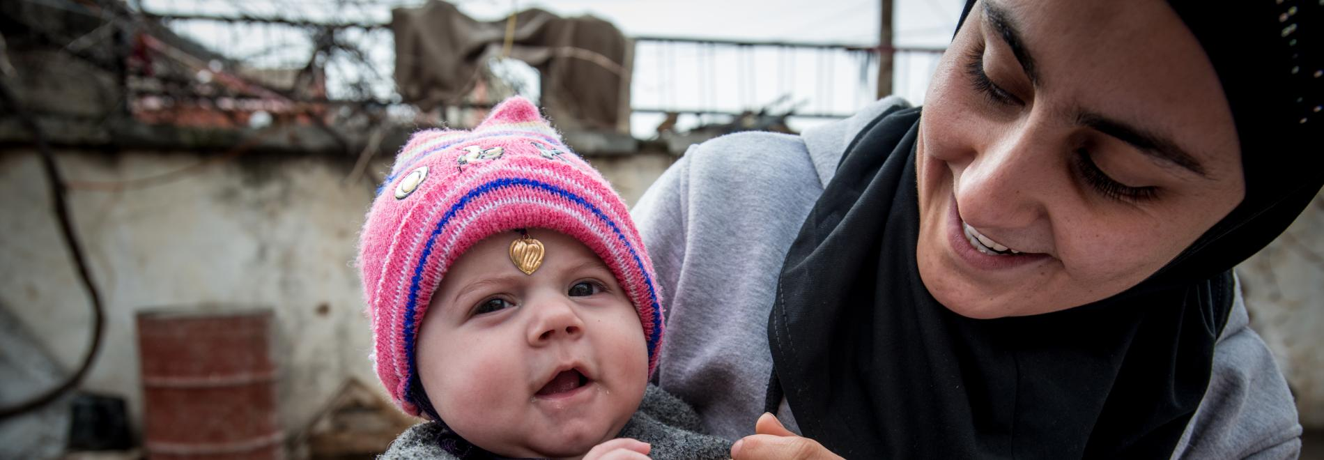 Mutter mit Kind im Irak. Foto: Guillaume Pinon