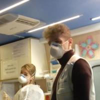 Mitarbeiter von open.med München mit Schutzmasken. Foto: Ärzte der Welt