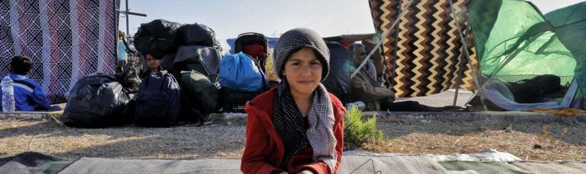 Kind im Flüchtlingscamp auf Lesbos. Foto: Yiannis Yiannakopoulos