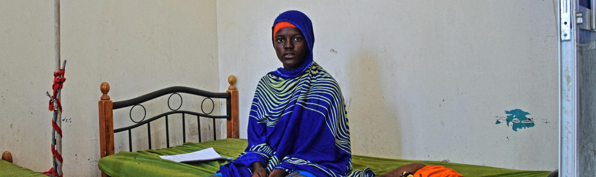Mutter mit Kind in einem Behandlungszentrum von Ärzte der Welt in Bosaso, Somalia. Foto: Jelle Boone