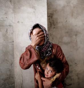 Eine verzweifelte Frau in Syrien. Foto: Ärzte der Welt